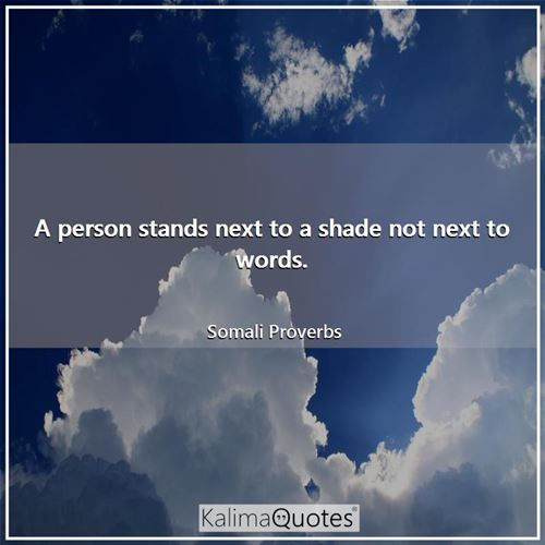 A person stands next to a shade not next to words.